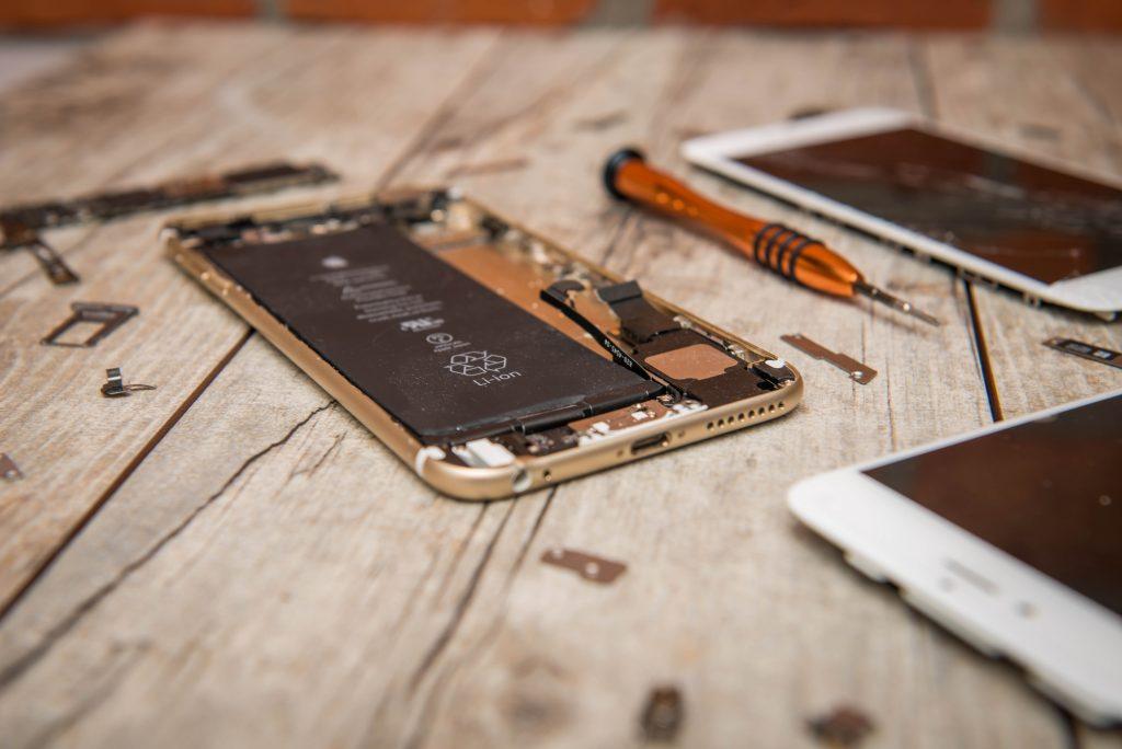 three broken iphones