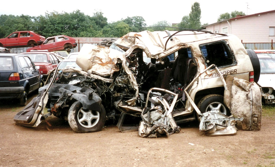 a wrecked car in a junk lot